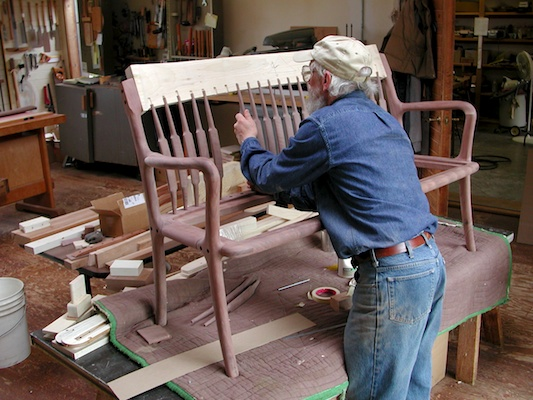 Edward working on settee