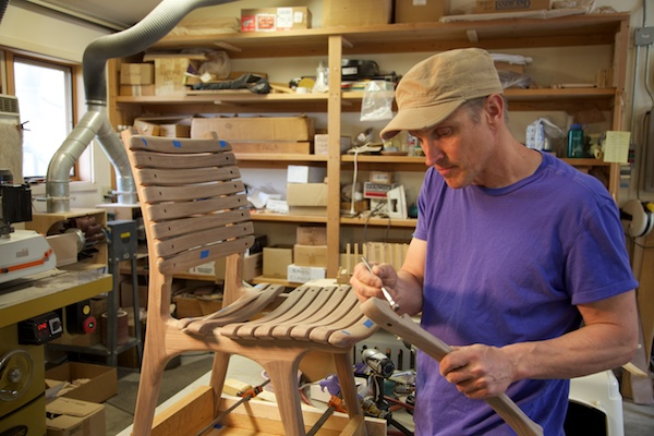 Steve works on a slat chair